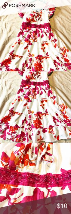 Euc. Girls size 7 Speechless summer dress Euc. Girls size 7 Speechless summer dress. White with pink and orange floral patter. Sequined band around waist and back tie. Speechless Dresses Casual