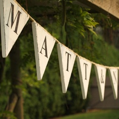 Custom Wedding Bunting Pennant Flag Garland Sign. Vintage Shabby Chic Cottage Style in Wood. Choose Your Names Words.  9 to 11 flags.. $40.00, via Etsy.