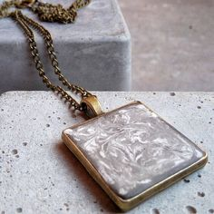 Marble effect with white cement in a concrete pendant. Very special and gorgeous necklace.