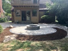 Custom patio and fire pit by Travis Prais