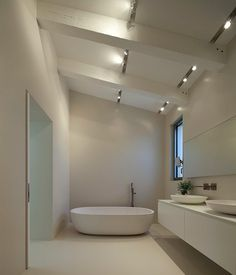 Retain the sense of volumme in the Master Bathroom by opening up the ceiling void. Add natural light with rooflight.