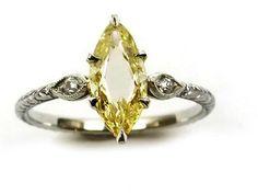 Single stone fancy yellow marquise portrait cut diamond, the 0.61ct stone claw set. S.J. Philips.