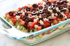 Hummus, yogurt, red onion, cucumbers, tomatoes, feta and olives are layered to create this delicious Greek inspired dip – grab a chip and serve this at your next party! You can prep all the ingredients ahead, but it's best to layer it just before serving as the cucumbers tend to get watery if they sit too long. If you don't eat dairy, or if you want to keep it vegan, skip the yogurt and add more hummus! Greek 7 Layer Dip Skinnytaste.com Servings: 9 • Serving Size: 1/4 cup • ...