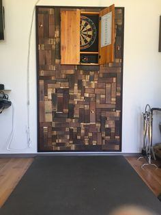 Used wine barrel slats to creat a protective and decorative wall for our dartboard. Dartboard Wall Protector, Dartboard Backer, Dart Board, Barrel, Basement, Youth, House Ideas, Wall Decor, Wine