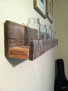 Old and weathered sunken barnwood shelf. Great for holding decorative figurines and pictures. 1x3 board at the center with two shelf supports