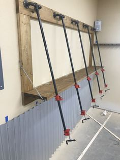 A vertical clamping station using pipe clamps and a fold down panel that creates an angled stacking plane. Garage Organization, Garage Storage, Organizing, Garage Workshop, Wood Workshop, Panel Saw, New Shop, Woodworking Tools, Wood Crafts