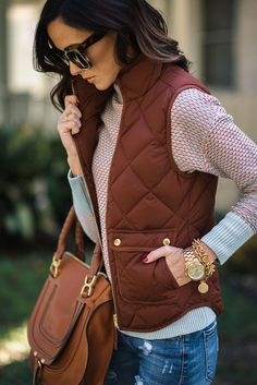 j.crew quilted vest with a long sleeve shirt, ripped denim and one great handbag.