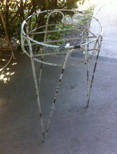 On the built-in stoep of Ouma's house were wire plant stands with ferns...