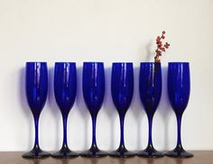 Vintage Champagne Glasses Cobalt Blue Toasting Flutes Set of Six Holiday New Years Eve Barware by ModRendition on Etsy https://www.etsy.com/listing/479311860/vintage-champagne-glasses-cobalt-blue