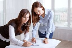 Photo: Female architects studying blueprints and make notes Studying, Architects, Notes, Stock Photos, Female, Report Cards, Building Homes, Notebook, Study