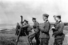 German officers scoping the Normandy beaches near the towns of Granville, and Saint-Père-sur-Mer shortly before the Allied invasion. Despite heavy fortification of the higher ground, the Germans failed to defeat the first wave of Allied landings on June 6, 1944.