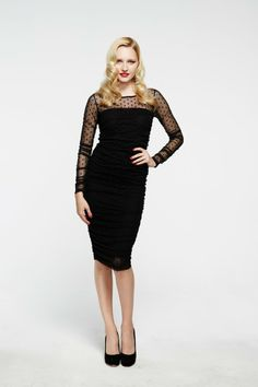 - Fitted and demurely sexy polka dot mesh dress with sheer full length sleeves and neckline. - Bodice is strapless and lined in modal jersey. - Rouching details along side seams give a flattering and forgiving fit on the body.