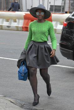 hat + cable-knit sweater + big skirt / Lupita Nyong'o