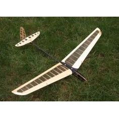 radio controlled balsa wood model airplane - could have textile panels inserted along wings?