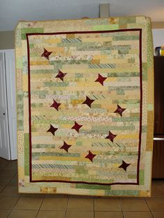 Jelly roll quilt with random Friendship Stars