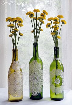 Doily decoupaged wine bottles. This would actually look really cool on clear glass vases or something.