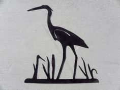 """Heron, Crane, Egret Bird in Reeds Silhouette Metal Wall Art Home Decor by JNJ Metalworks. $19.99. We can create logos, names, words and much more.. Made in the USA. High Quality 16th Inch Steel. Custom Orders Accepted. Rust Resistant Paint. Metal Wall Art Decor HERON, CRANE EGRET In Reeds, Made Of Steel, Painted Black, In New Condition, Measures 17"""" Wide By 18"""" Tall. Made from High Quality 16th inch Steel, Painted Black, In New Condition, Check out my other items!..."""