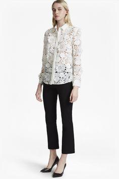"<ul> <li> Sheer and textured 3D floral lace shirt with contrast, solid crepe back</li> <li> Point collar</li> <li> Long cuffed sleeves</li> <li> Curved hem</li> <li> Concealed button front</li> <li> Loose fit —falls freely over the body</li> <li> UK size 10 centre-back length is 70cm</li> </ul>  <strong>Our lead model is 5ft 10"" and is wearing ..."