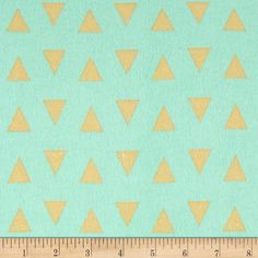 Comfy Flannel Triangles Mint from @fabricdotcom  This double napped (brushed on both sides) flannel is perfect for quilting and apparel. Colors include shades of mint green and tan.