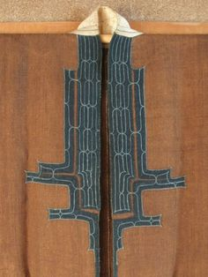 detail of AINU ATTUSH CEREMONIAL KIMONO.  HAND-PLIED, HANDWOVEN ELM (Ulmus lacinata) BAST  ASSEMBLED WITH HEMP THREAD, COTTON APPLIQUED  AND COUCH EMBROIDERED WITH COTTON THREAD  HOKKAIDO, MID 19C