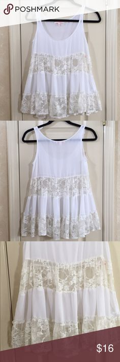 White Lace Tank White flowy tank top with lace panels. 100% polyester. Margo and Sebastian Tops Tank Tops