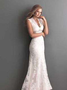 This plunging neckline takes a traditional lace dress from subtle to sassy. Allure Bridals