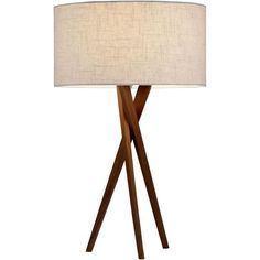 A sleek light walnut tripod base suits a variety of settings from contemporary, masculine, transitional to loft style. The legs attach to a metal disc that supp