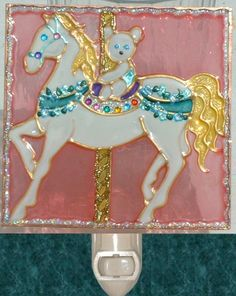 Pink Carousel Horse Night Light With Teddy Bear. Stained glass nightlight hand painted on textured art glass for carousel gifts and theme decor. Decorative creative artwork made by Pat Desmarais in the USA.  $25.00