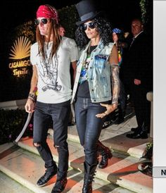 Cindy Crawford and hubs as Slash and Axl