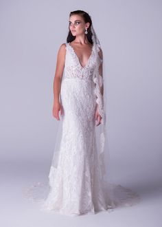 Viola Chan wedding dress, Open back mermaid dress with an exquisite beaded lace design and low plunging neckline.