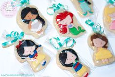 3 1/2 inch Shortbread Cookies decorated in a sugar glaze.  I shortened up the dresses and added the little shoes to them (similar to the ballerina themed Princess cookies I made a few months ago).  120 for wedding favors- a lot of work but super cute!