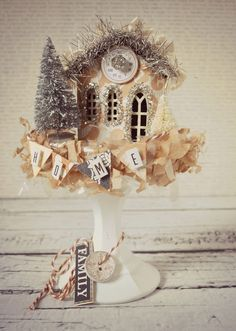 STICH PLATE ON TOP OF CANDLESTICK, PAINT, AND DISPLAY MINITURE XMAS TREASURES. OOO A LIGHT INSIDE THE WEE HOUSE BE SWEET.