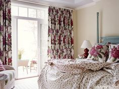 Here's fabric-driven decor at its splashiest — an entire master bedroom in a Wisconson lake cottage worked around Carleton V's exuberant floral print, Rhodendron. Design: Carleton Varney.