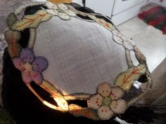 Six inch linen base doily, cutwork with applied layered motifes all edged in blanket stitch.