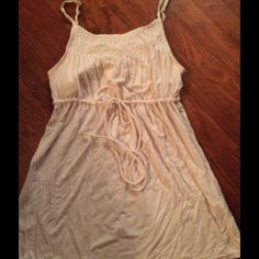 VS pretty top w built in bralette.  Tunic length. Sweet, adjustable spaghetti strapped top with drawstring waist.  Pretty gathered detailing at top of front and back.  Tunic length in light cream.  So soft!  93% modal/7% spandex. Victoria's Secret Tops Blouses