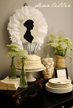 Jane Austen tea party, I love the use of the silhouette and keeping it black and white does give it a clean look but I would probably want to pair it with a blue willow china pattern or something reminiscent to regency dinnerware.