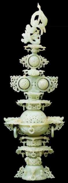 """CARVED APPLE GREEN JADE DRAGON  PHOENIX CENSOR Stunning apple green jade Censor. Has a dragon and Phoenix design to top. Has 40 figural dragon handles with relief carved rings. Has 3 reticulated spinning balls. Scrolled design throughout with reticulation. 19th century. Measures 37"""" height + 4"""" base"""