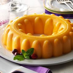 Mango Gelatin Salad Recipe -My Aunt Nannette shared this smooth and refreshing salad as a convenient do-ahead dish. The mango and apricot flavors go well with pork, chicken and beef. Köstliche Desserts, Delicious Desserts, Holiday Desserts, Christmas Recipes, Dessert Recipes, 1950s Food, Congealed Salad, Gelatin Recipes, Mango Jello Recipes