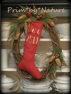 Primitive Stocking wreath hanging on a cupboard.