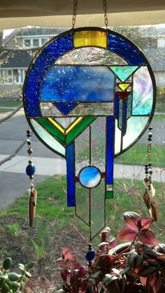 Handcrafted stained glass dreamcatcher.  I made it for a friend's daughter.