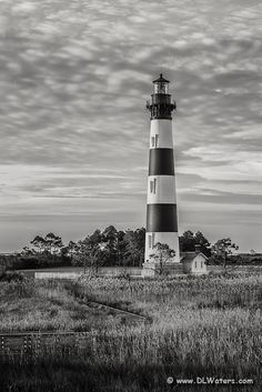 Black-and-white portrait of bodie Island Lighthouse. Bodie Island Lighthouse stands 156 feet tall and the height of each stripe is 22 feet. ...