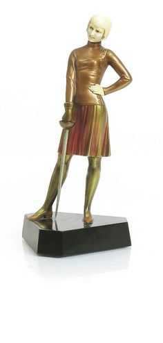 λ   'Fencer' a cold painted bronze and ivory figure cast and carved from a model by Ferdinand Preiss