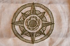 Blackwork embroidered cop cover for my husband. His persona is an Elizabethan privateer, so I incorporated both a Tudor rose and a compass rose. Viking Embroidery, Tudor Rose, Rose Leaves, Compass Rose, Diy Camping, Gold Work, Blackwork, Vikings, Medieval