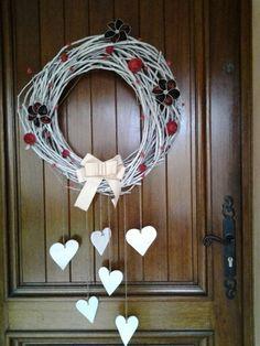 Couronne de noel décorée avec fleurs en capsules nespresso