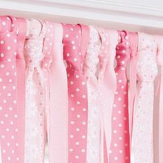 Make a no sew valance with thick ribbon strips tied to rod!