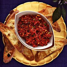 Sun-Dried Tomato Tapenade - SO YUMMY! - 1 jar sun-dried tomatoes in oil, 1/4 c. walnuts (toasted), 1 T chopped parsley, 1/4 t salt, 1/4 t pepper. - Pulse in a food processor