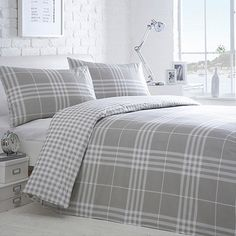 From our great Home Collection Basics range of bed linen, this grey checked duvet and pillowcase set has a large check on one side and a small checked design on the reverse.