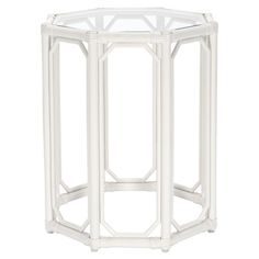 With a geometric openwork silhouette and white finish, this glass-topped rattan end table pairs natural style with vibrant appeal.