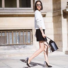 Instagram's #EvaChen elevates her monochrome look with fierce studded pumps. #PFW #streetstyle by theurbanspotter