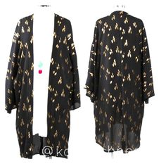 Black w/ Gold Foil Print Kimono Cardigan     Gorgeous long sleeve gold foil print open front cardigan---Kimono style---Woven Polyester---Made in USA---Runs true to size---                             Price is firm unless bundled ---  Thank  you for visiting my closet and Happy Poshing.  Top Trends Party Host Pick Sweaters Cardigans